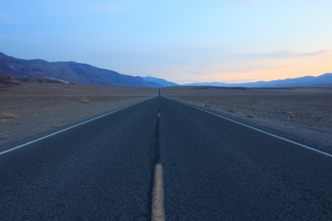 Sunset over Badwater road in Death Valley